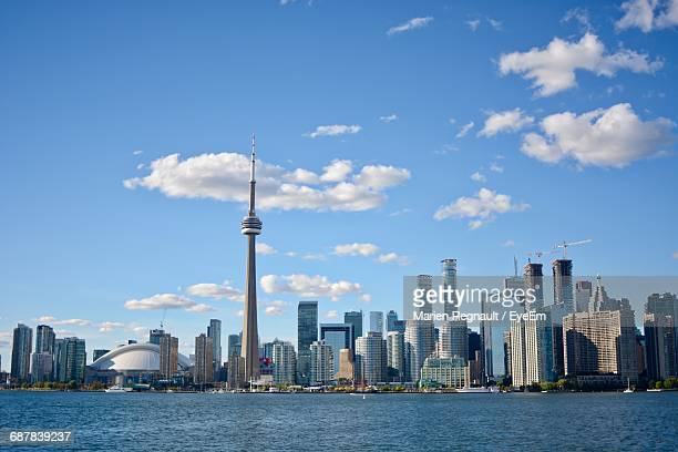 modern city by sea against sky - cn tower stock pictures, royalty-free photos & images