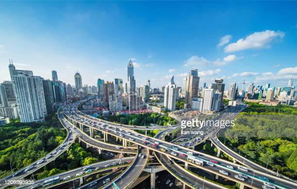 modern city with highway interchange - stock photo - wang he stock pictures, royalty-free photos & images