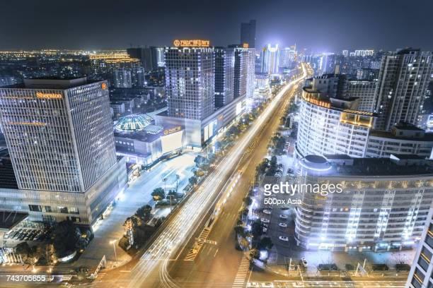 modern cityscape at night, changzhou, jiangsu, china - changzhou stock pictures, royalty-free photos & images
