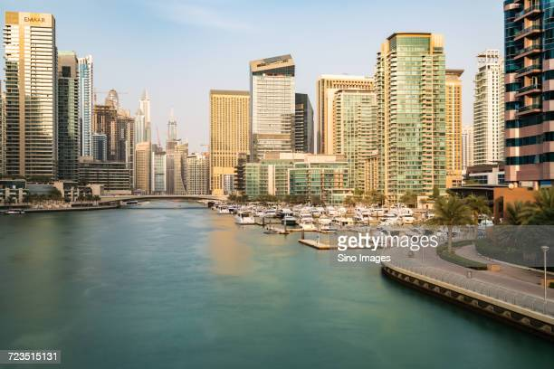 modern cityscape at sunset, dubai - image stock pictures, royalty-free photos & images