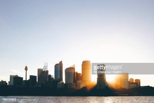 modern cityscape by river against clear sky - sydney stock pictures, royalty-free photos & images
