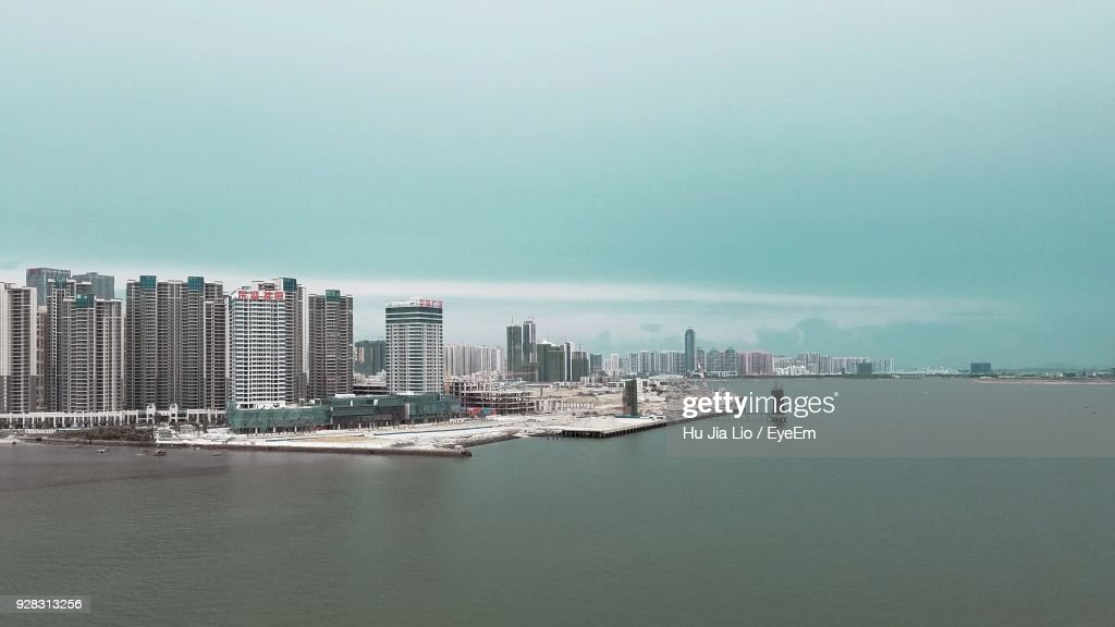 Modern Cityscape By Sea Against Clear Sky : Stock Photo