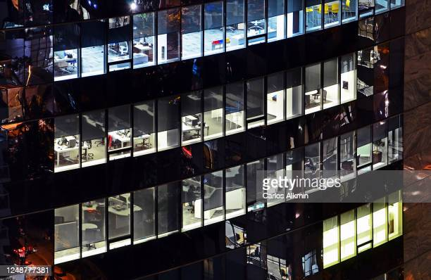 modern commercial building in sao paulo, with empty workstations viewed through its windows - carlos alkmin stock pictures, royalty-free photos & images