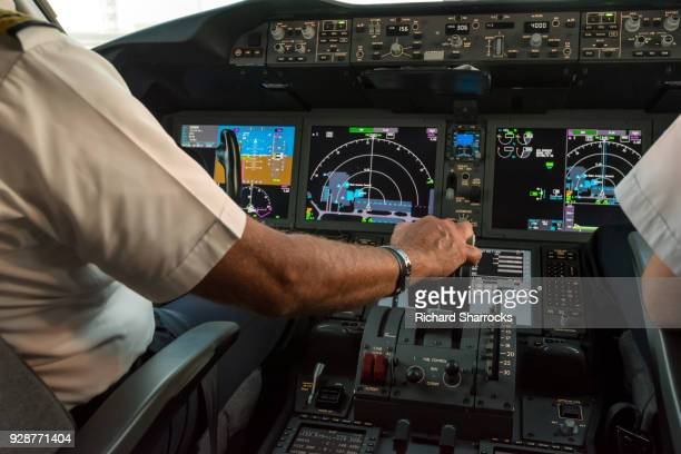 modern commercial jet aircraft cockpit and pilots - piloting stock pictures, royalty-free photos & images