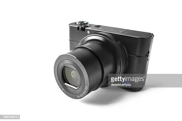 Modern compact camera on white
