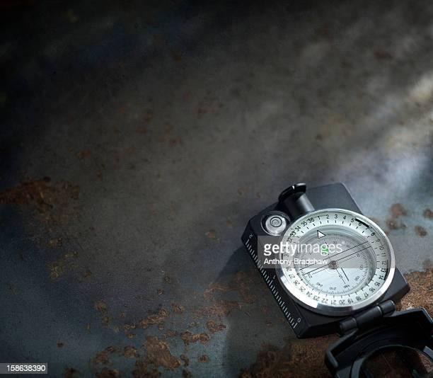 Modern compass on dark blue textured background