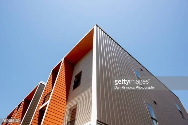 modern condominiums - housing development stock pictures, royalty-free photos & images