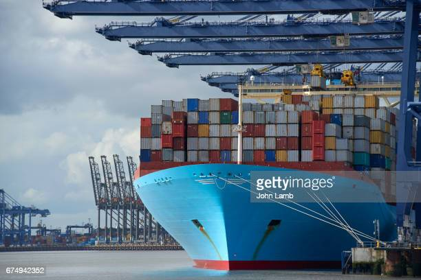 Modern container ship being unloaded