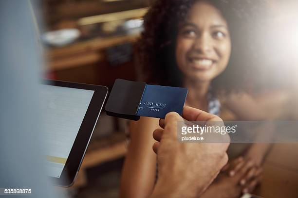 modern convenience making life easier - credit card reader stock pictures, royalty-free photos & images
