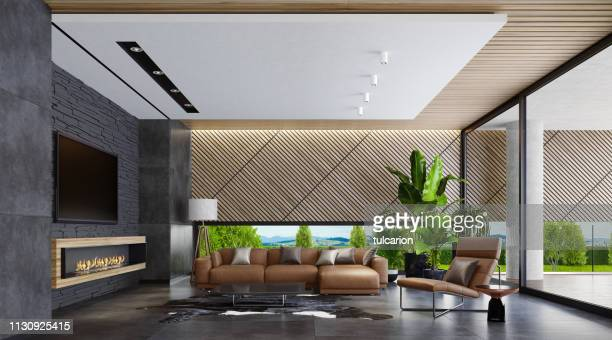 modern country style villa living room with eco fireplace - modern hotel lounge stock pictures, royalty-free photos & images
