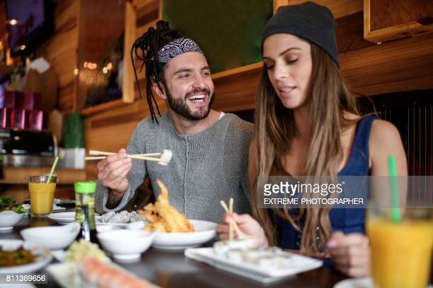modern couple - sushi restaurant stock photos and pictures