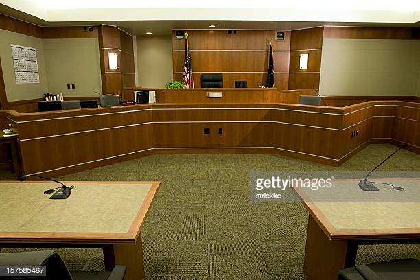 modern courtroom with judge's bench, attorneys' desks medium wide angle - courtroom stock pictures, royalty-free photos & images