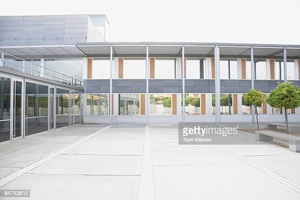 modern courtyard and office building - courtyard stock pictures, royalty-free photos & images