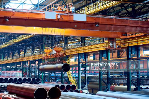 Modern crane moving steel pipe