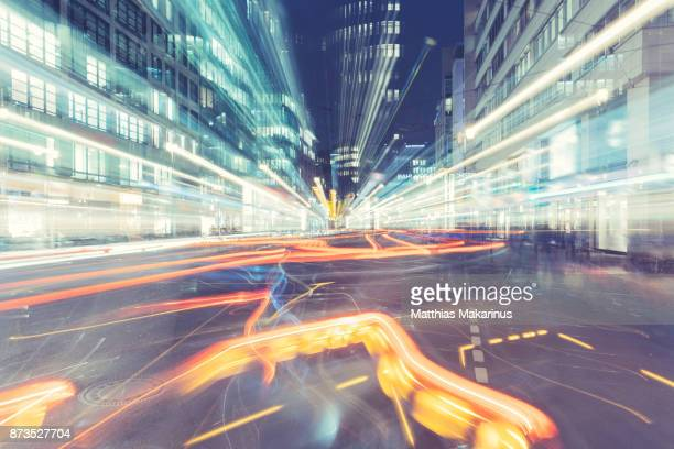modern creative zoom rush hour night street szene in berlin with traffic lights - stadtviertel stock-fotos und bilder