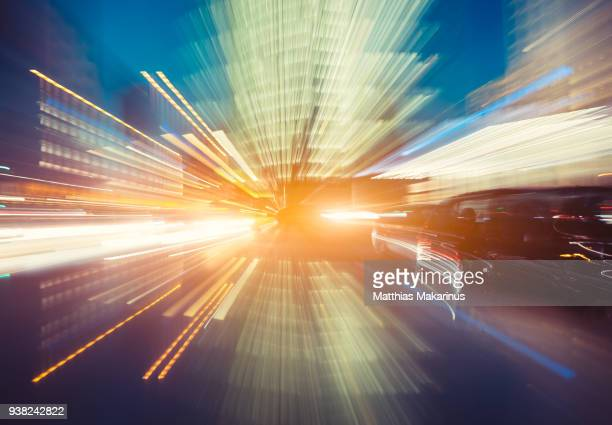 modern creative zoom rush hour night street szene in berlin with traffic lights - futurism stock photos and pictures