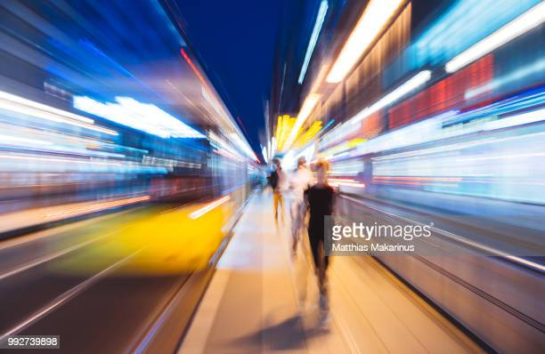 modern creative zoom rush hour night street szene in berlin with traffic lights - motion blur stock photos and pictures