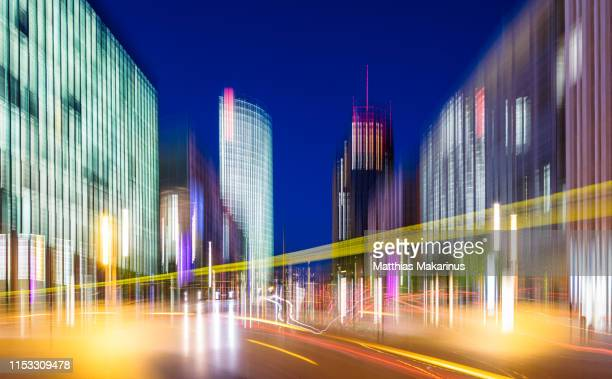 modern creative zoom skyline business district night scene in berlin with lights and traffic - makarinus stock photos and pictures