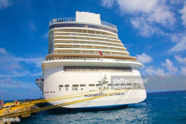 Modern cruise ship with lines tied to pier in the Yucatan