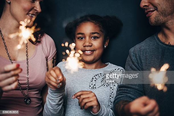 Modern cute family with sparklers