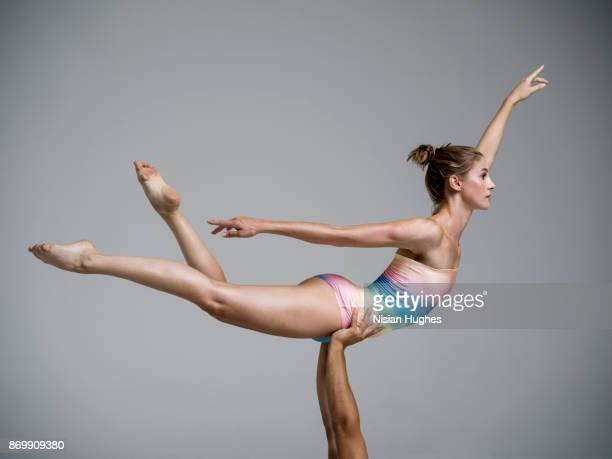 Modern Dancer being lifted while dancing in studio