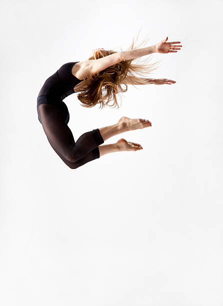 modern dancer jumping in the air