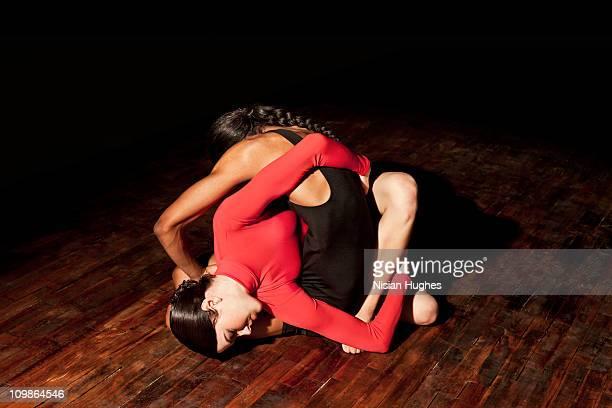 modern dancers twisting around each other