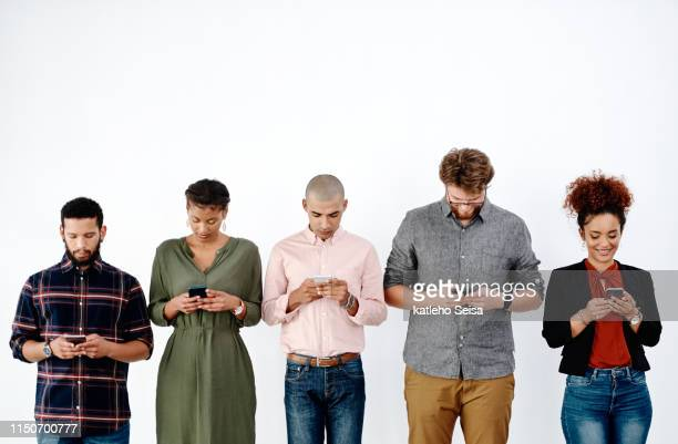 modern day entrepreneurs are well connected - people in a row stock pictures, royalty-free photos & images