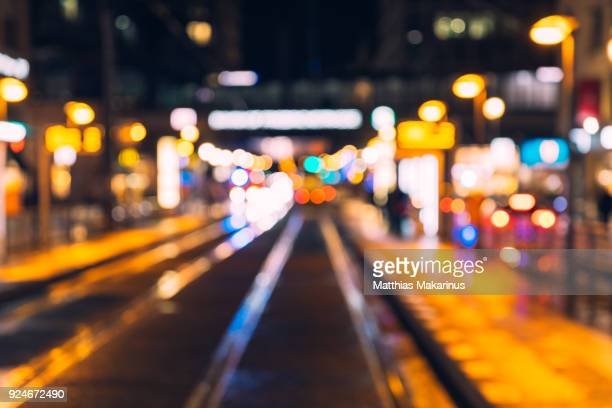 modern defocused berlin rush hour night city szene with traffic and bokeh lights - makarinus stock photos and pictures