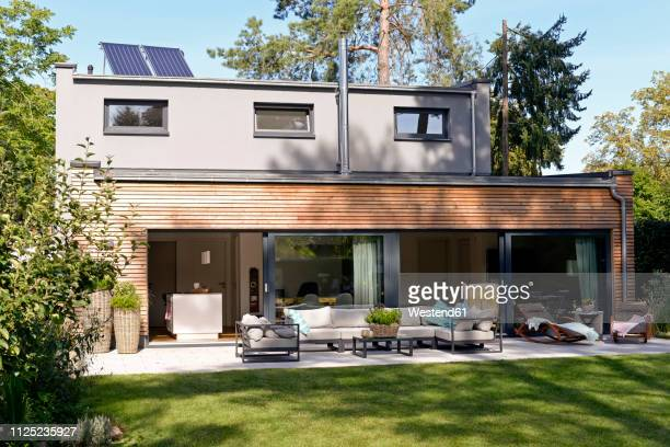 modern detached house with terrace and garden - house stock pictures, royalty-free photos & images