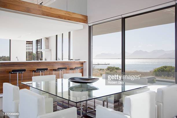 modern dining room overlooking patio - dining room stock pictures, royalty-free photos & images