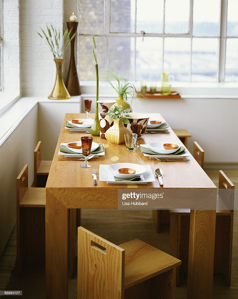Modern dining room table : Stock Photo