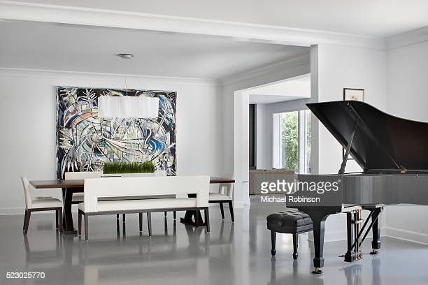 modern dining room with grand piano, chicago il - mid century modern stock pictures, royalty-free photos & images
