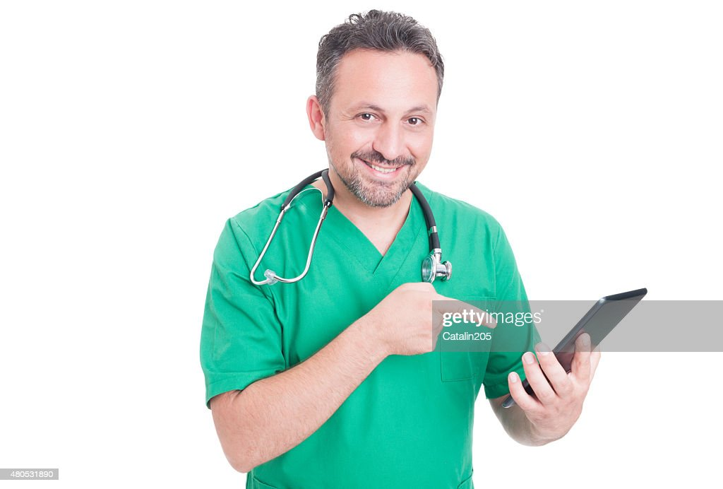 Modern doctor holding tablet : Stock Photo