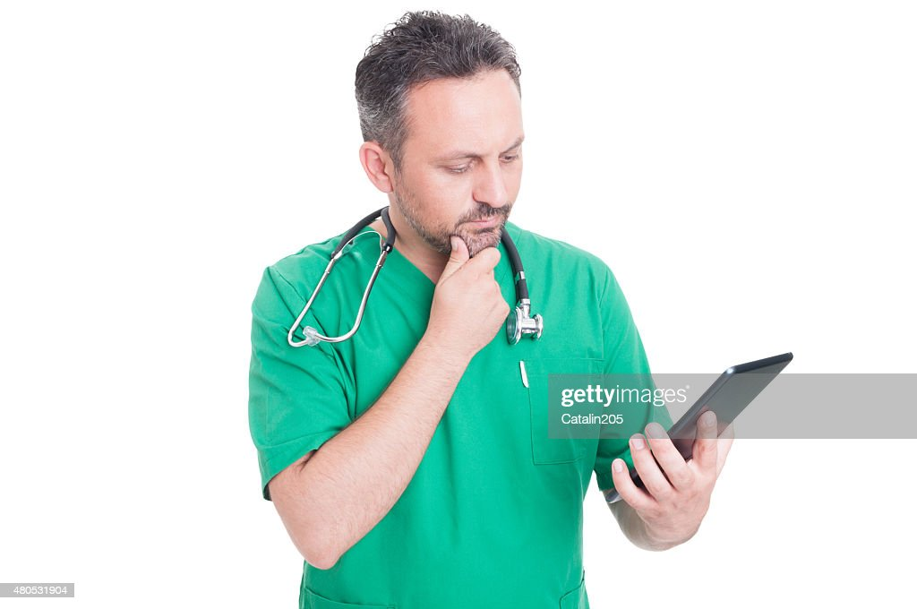 Modern doctor using wireless tablet : Stock Photo