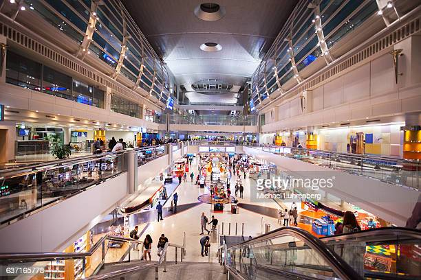 modern duty free shopping area - dubai airport stock photos and pictures