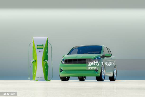 modern electric car with electric charging station - electric vehicle charging station stock pictures, royalty-free photos & images