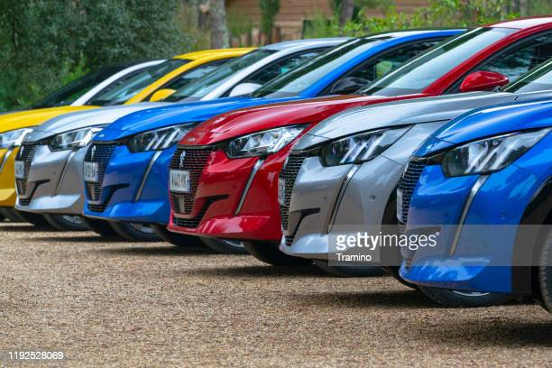 modern electric peugeot vehicles on a parking - 2019 stock pictures, royalty-free photos & images