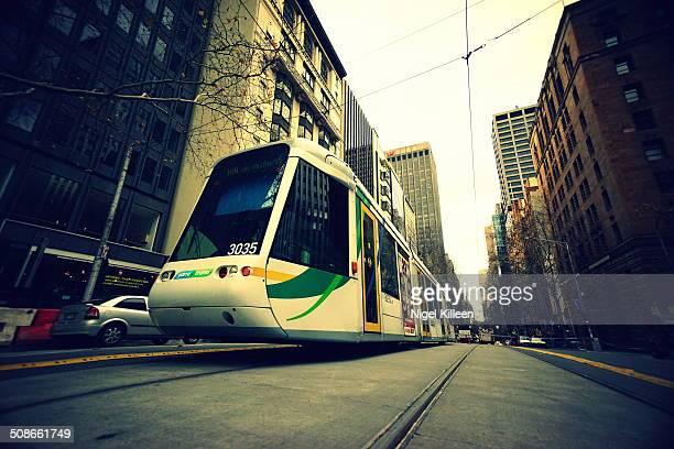 Modern electric tram Collins Street Melbourne Australia