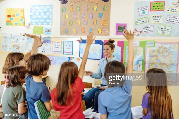modern elementary education in latin america - teacher sharing knowledge with school children, using technologies and internet - knowledge is power stock pictures, royalty-free photos & images
