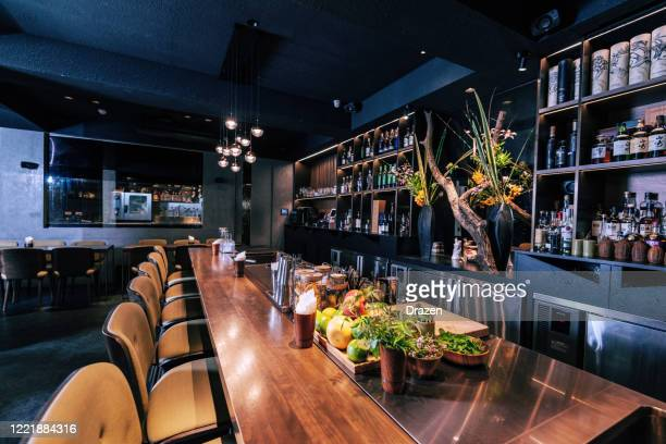 modern empty cafe or night club, closed down during pandemic lockdown - recessed lighting stock pictures, royalty-free photos & images