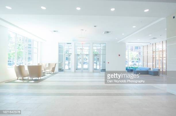 modern empty lobby - chairperson stock pictures, royalty-free photos & images