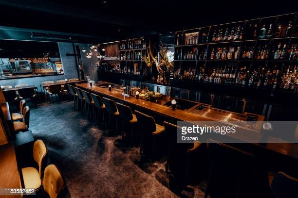 modern empty night bar waiting for guests. - bar stock pictures, royalty-free photos & images
