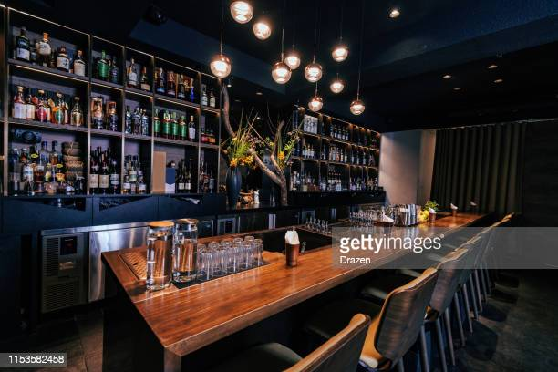 modern empty night bar, wide angle shot - bar stock pictures, royalty-free photos & images
