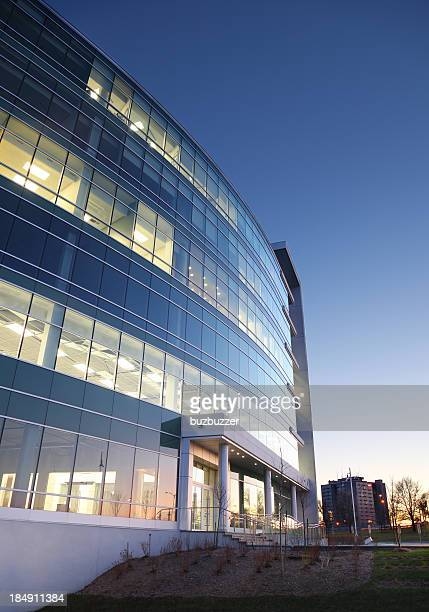 modern entreprise exterior at sunset - headquarters stock pictures, royalty-free photos & images