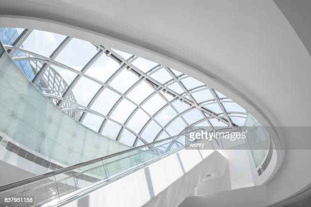 modern escalator - curve stock photos and pictures