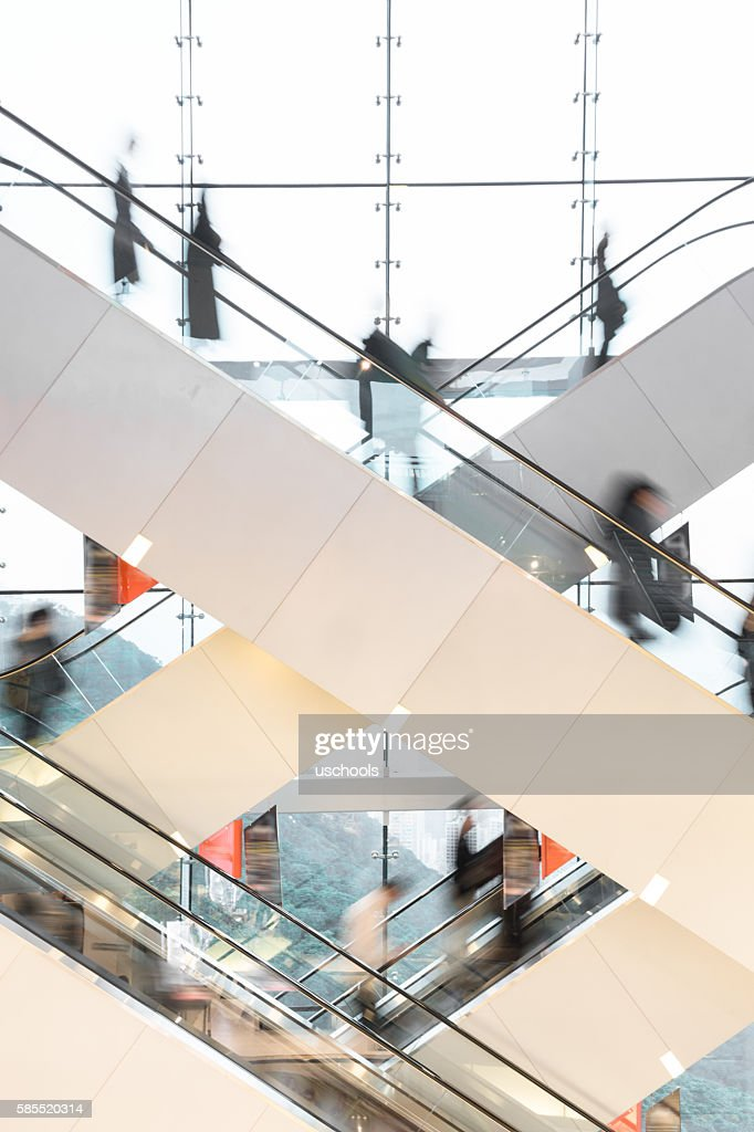 Modern Escalator with blurred people : Stock Photo