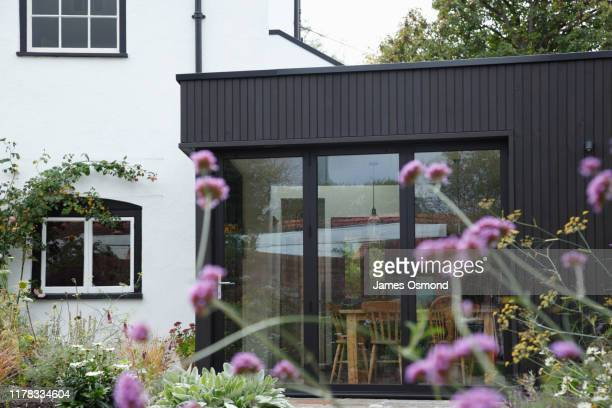 modern extension built onto the side of a listed period property. - door stock pictures, royalty-free photos & images