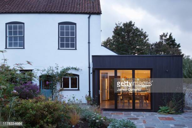 modern extension built onto the side of a listed period property. - facade stock pictures, royalty-free photos & images