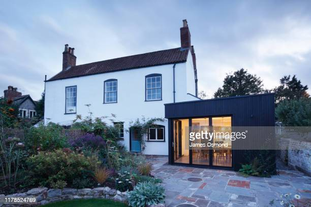 modern extension built onto the side of a listed period property. - cottage stock pictures, royalty-free photos & images